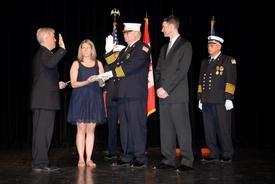 Pictured: Suffolk County Executive Steven Bellone installs Donald Corkery as president of the New York State Association of Fire Chiefs as his children, Kate and Brian, look on. Photo by: Dennis Whittam/Fire News